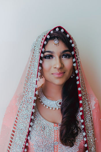 Close-Up Portrait Of Bride Wearing Traditional Wedding Dress