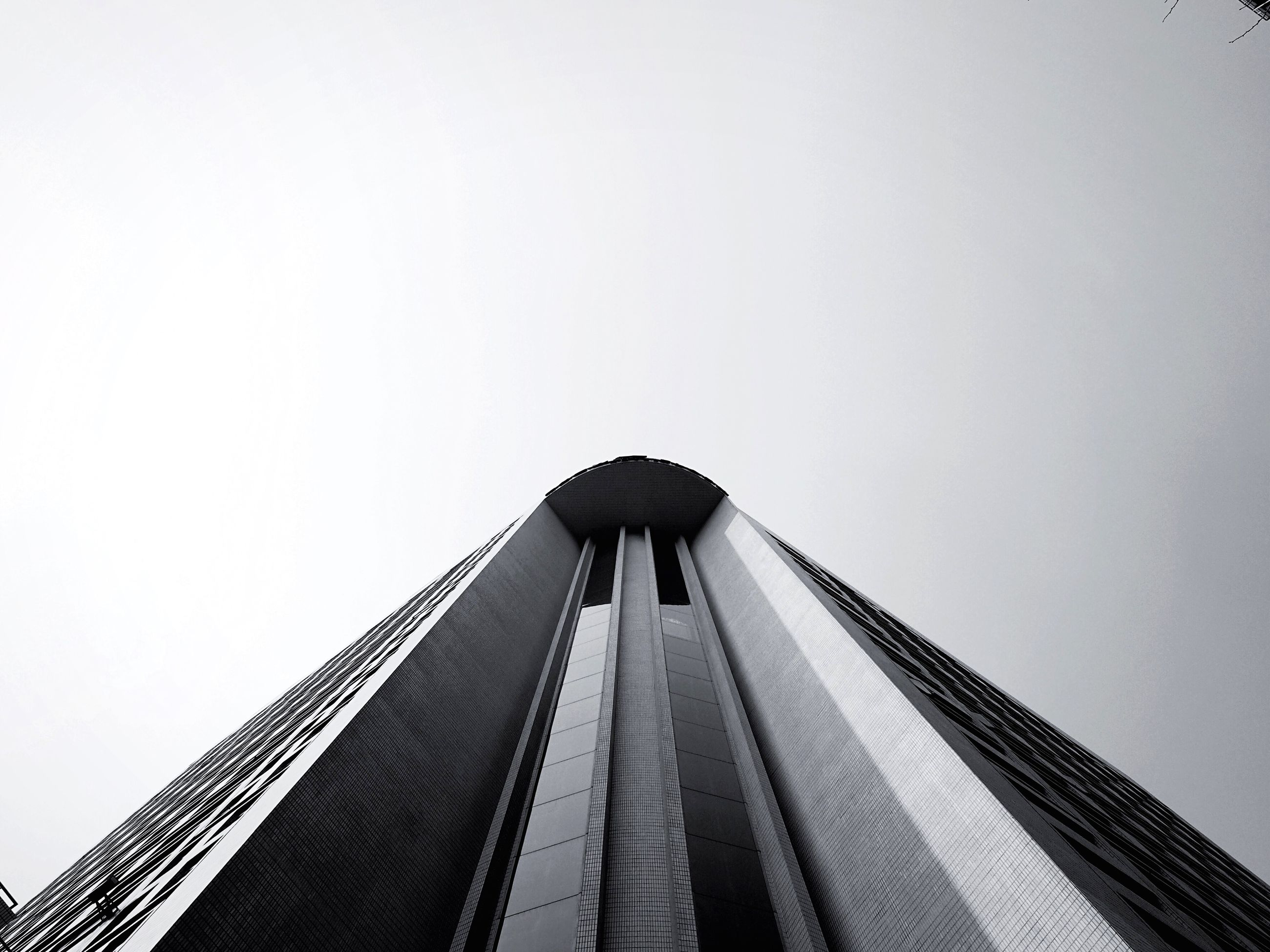 architecture, built structure, low angle view, clear sky, building exterior, copy space, modern, tall - high, skyscraper, city, tower, office building, outdoors, tall, day, sky, capital cities, travel destinations, building, city life