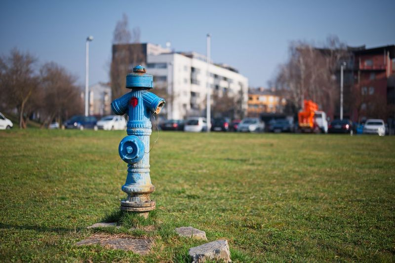 Close-up of fire hydrant on field against clear sky