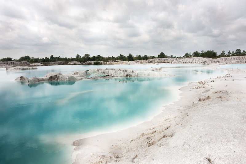 Man-made artificial lake Kaolin, turned from mining ground holes. Due to mining, holes were formed covered by rain water, forming a clear blue lake, Air Raya Village, Tanjung Pandan, Belitung Island. Artificial Lake Asia Landscape Belitung Blue Colored Blue Lake Bright Water Clear Clear Water Clearwater Colored Water Groundholes Holiday INDONESIA Island View  Kaolin Lake Kaolinite Lake Landscapes Mining Heritage Reflection Lake Reflections In The Water Travel Destinations Water Water Reflections White Color