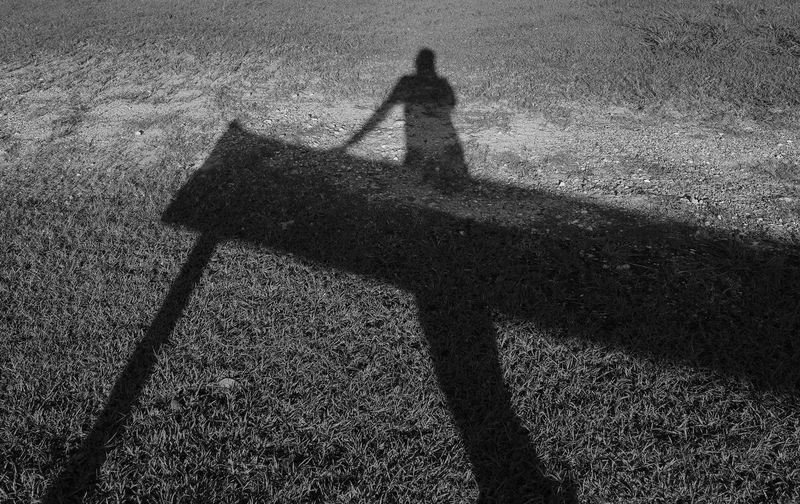 Day Focus On Shadow Grass Land Lifestyles Monochrome Nature One Person Outdoors Plant Shadow Silhouette Standing Sunlight