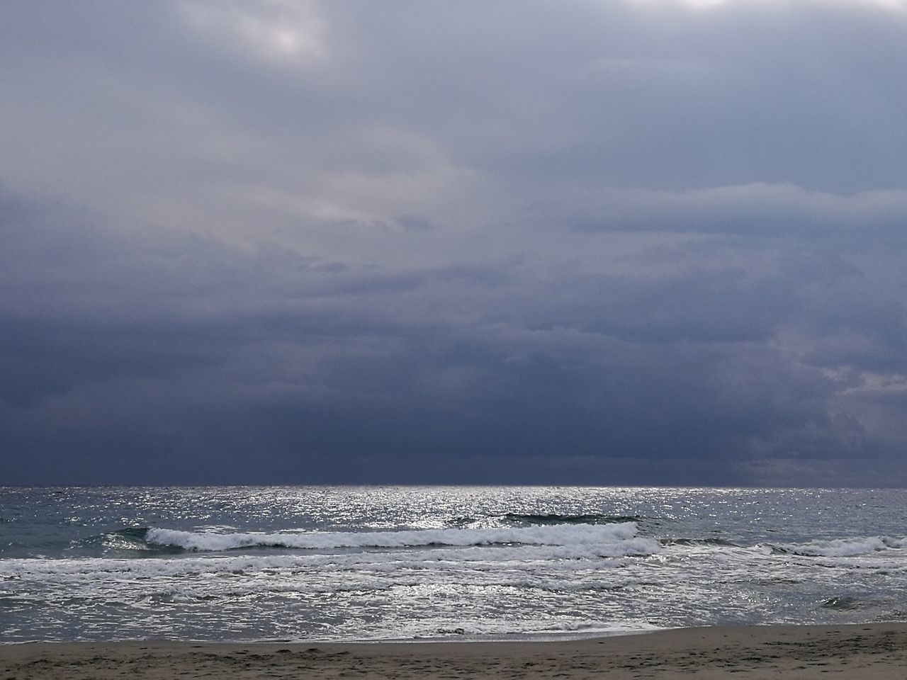 sea, water, horizon over water, beauty in nature, scenics, sky, nature, tranquility, beach, cloud - sky, tranquil scene, outdoors, no people, wave, day, storm cloud