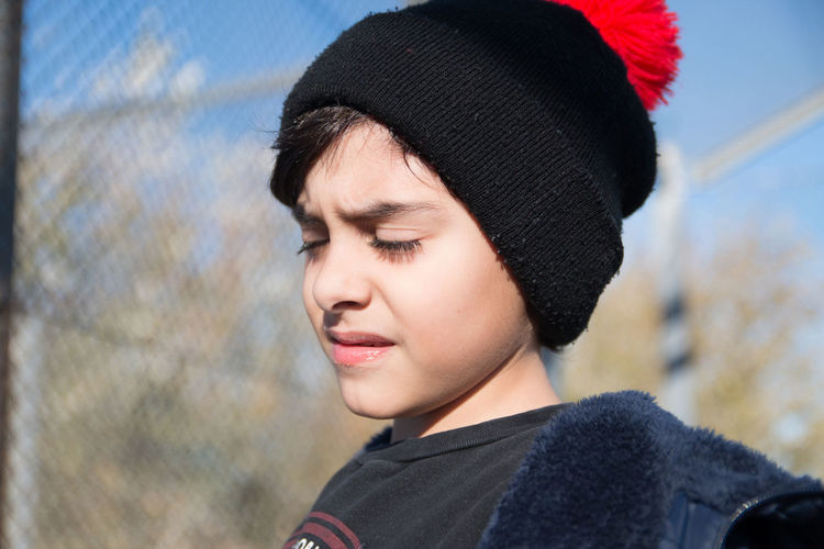 Close-up portrait of boy looking at camera
