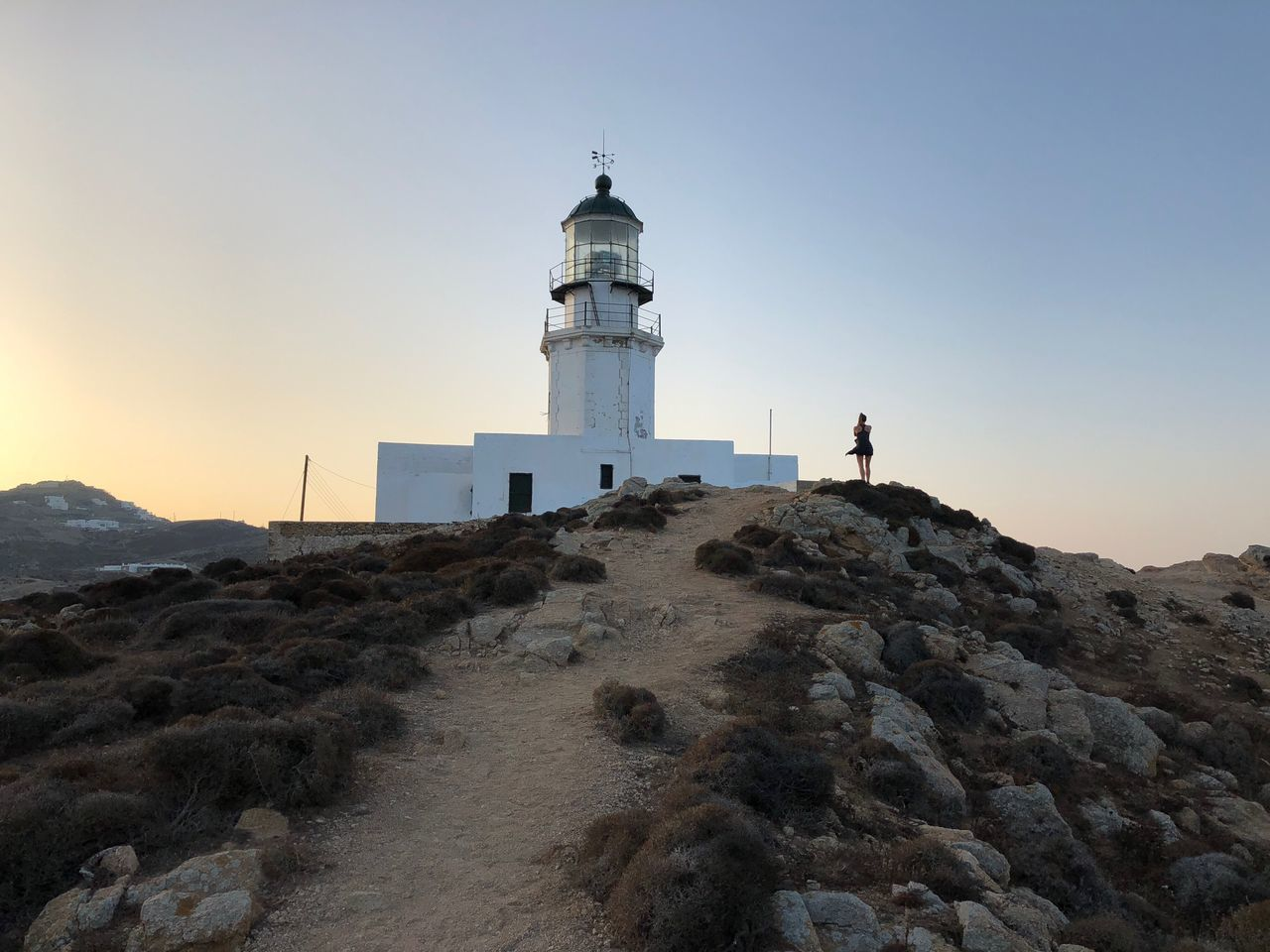 lighthouse, guidance, direction, safety, protection, architecture, security, building exterior, built structure, tower, nature, sky, sea, sunset, clear sky, beach, outdoors, scenics, cliff, travel destinations, sand dune, day, beauty in nature, no people