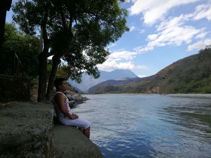 One Person Relaxation One Woman Only Full Length Beauty In Nature Tranquility Mature Men Travel Destinations Selva Peruana Sky Quibamba-Cusco Water