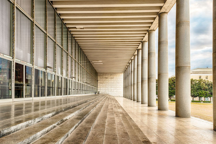 The scenic Palace of Congress in the Eur District, Rome, Italy Architectural Column Architectural Feature Architecture Built Structure Column Corridor Day Diminishing Perspective Empty In A Row Modern No People Repetition Sky The Way Forward Vanishing Point