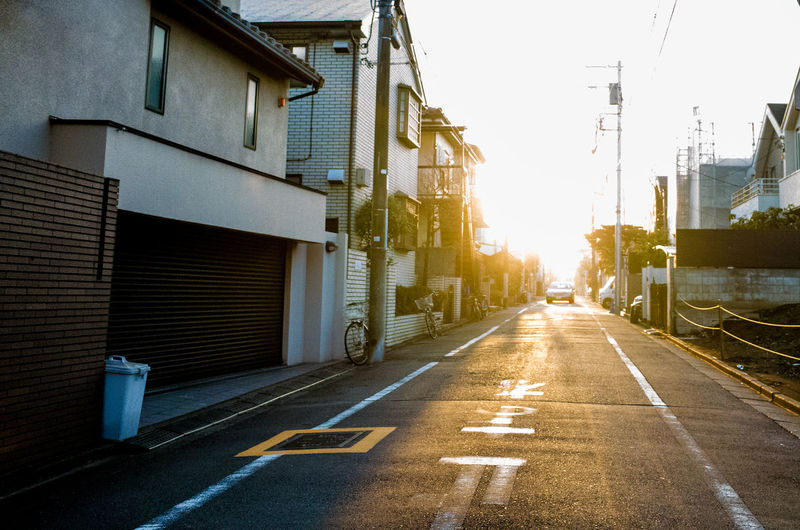 Architecture Shadows & Lights Streets Sunlight Architecture Building Exterior Built Structure City Day Lines And Shapes No People Outdoors Road Sky Street Street Photography Sun Beams Sunshine The Way Forward Tokyo Streets Transportation Adventures In The City Autumn Mood Capture Tomorrow