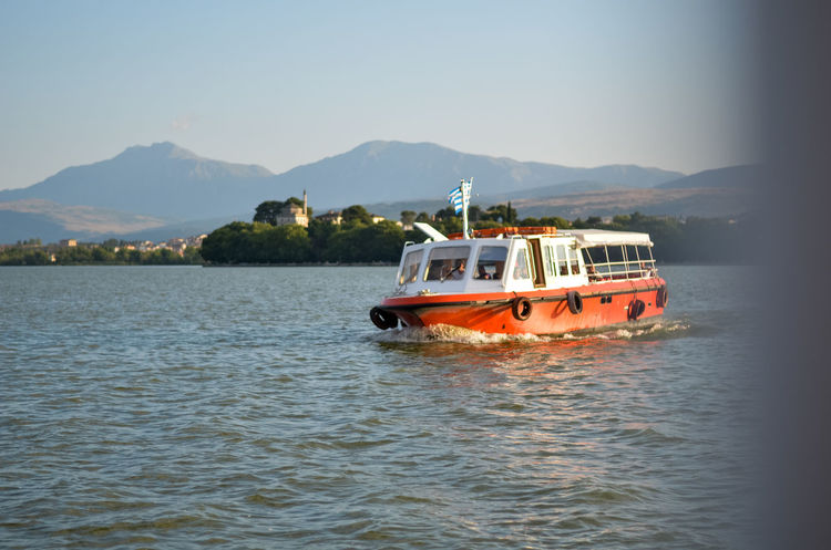 A boat making the standard route at lake Pamvotis in Ioannina, Greece. Boat Day Greece Ioannina Lake Landscape Mountain Nature Outdoors Pamvotis Sailing Sky Trees Water