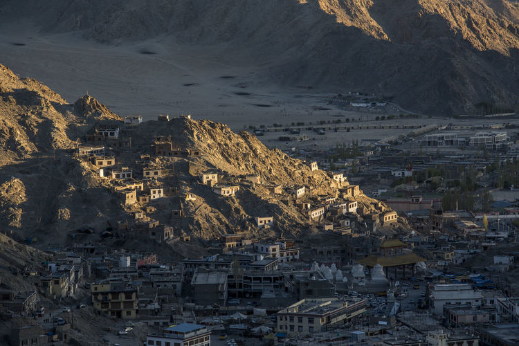 Leh ladakh city India Ladakh Architecture Building Building Exterior Built Structure City Cityscape Crowd Crowded Day High Angle View Leh Mountain Mountain Range Nature Outdoors Residential District Rock Sea Town TOWNSCAPE Water