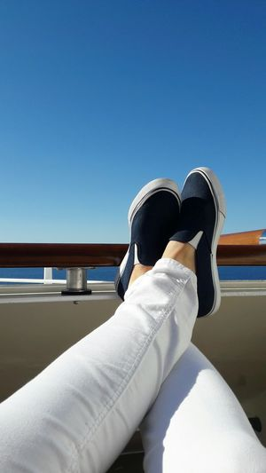 Clear Sky Vacations Relaxation Outdoors Shoes Blue Sky Blue Blue Shoes Foot Feet Feel The Journey Feeling Good Enjoying The Sun Enjoying The View Sailing Cruising Cruise Sitting Alone Sitting Outside Sitting In The Sun Minimalism Blue And White Seascape