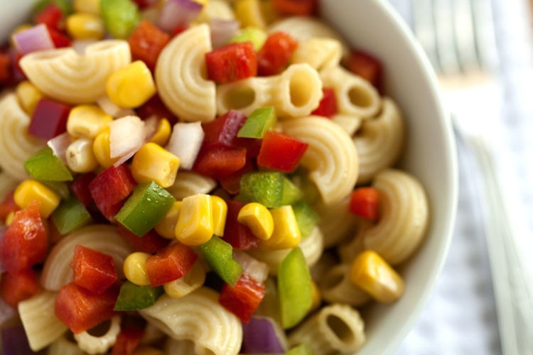 Summer Macaroni Salad bowl. Lateral view. with fork. Natural Light Salad Close-up Corn Grain Focus On Foreground Food Food And Drink Freshness Green Peppers Healthy Eating Macaroni Pasta Macaroni Salad  No People Ready-to-eat Red Peppers Studio Photography Summer Salad
