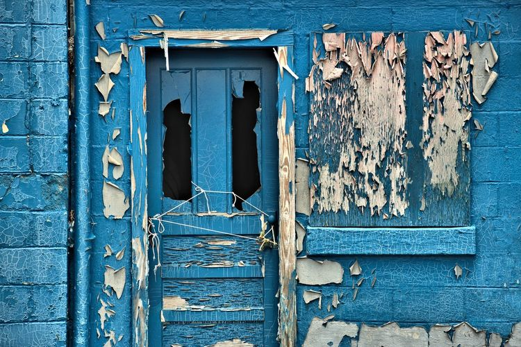 Exterior Of Blue Abandoned House