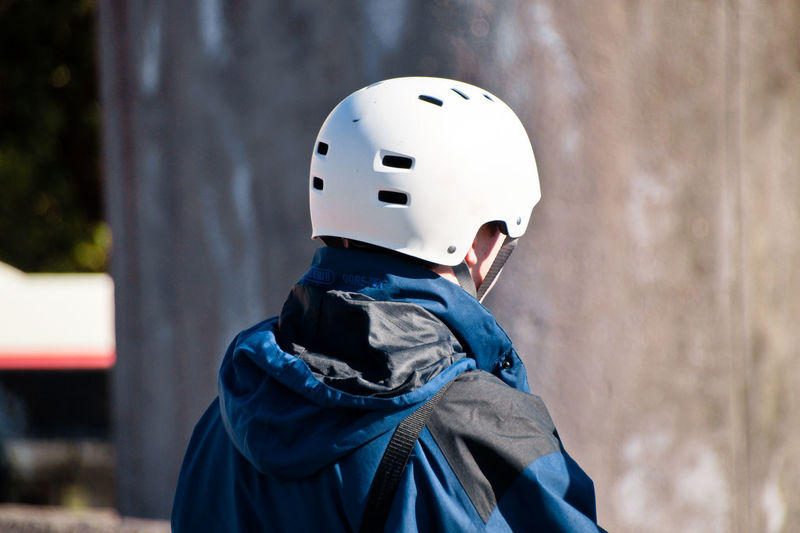 Man wearing cycling helmet on sunny day