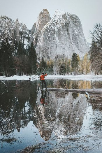 Cold morning at Yosemite National Park Mountain Nature Scenics Snow Beauty In Nature Mountain Range Reflection Lake Water Winter Cold Temperature Rock - Object Outdoors One Person Adventure Day Sky Clear Sky Real People Tree Perspectives On Nature EyeEmNewHere Fresh On Market 2017 The Great Outdoors - 2018 EyeEm Awards