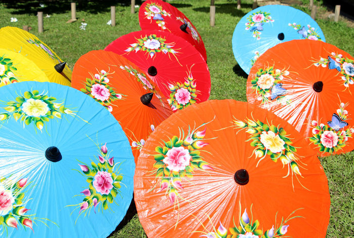Colorful umbrellas are indigenous handicrafts in Thailand. Green Grass Colourful Thailand Thai Travel Health Healthcare Lifestyle Lifestyle People Summer Holiday Recreation  Relax Business Handmade Handicraft Indigenous  Craft Art Art And Craft Flower Flower Head Multi Colored Close-up Umbrella Rainy Season Male Likeness Human Representation Craft Product Sculpted
