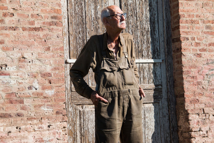 Senior adult man with working clothing