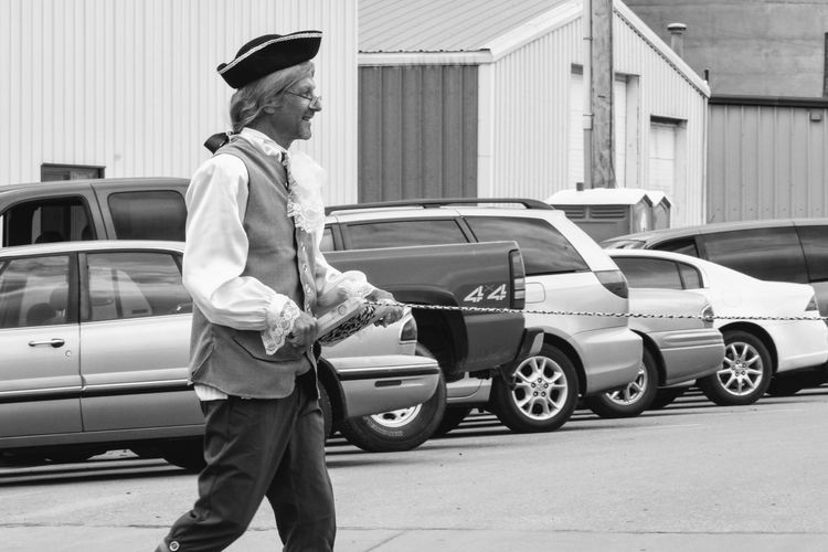 Village of Plymouth 125th Anniversary Celebration August 13, 2017 Plymouth, Nebraska Americans Camera Work Community EventPhotography FUJIFILM X-T1 MidWest Nebraska Plymouth, Nebraska Small Town America Summertime Takumar 135mm F3.5 Adult Architecture Ben Franklin Building Exterior Car Costume Day Electricity  Full Length Holding Land Vehicle Manual Focus Men Mode Of Transport One Person Outdoors Parade People Practicing Photography Real People Small Town Small Town Life Small Town Stories Standing Stationary Streetphoto_bw Streetphotography Transportation Young Adult