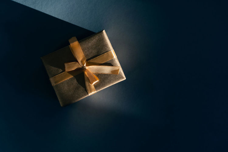 High angle view of paper box against black background