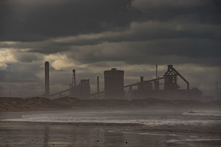 Industry at Redcar. Sky Cloud - Sky Water Environmental Issues Land Pollution Factory Air Pollution Environment Overcast Outdoors Industry No People Sea Teesside Yorkshire North East England Industry Industries England Uk Europe European  Building Exterior Architecture