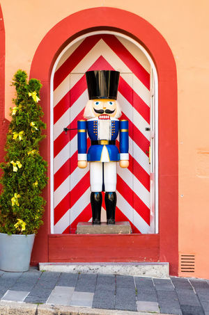 Portrait of nutcracker standing against red wall. Child Childhood Portrait Boys Males  City Red Looking At Camera #urbanana: The Urban Playground