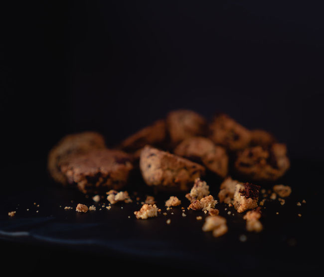Chocolate Chip Cookie Cookies Dark Food And Drink Snack Snack Time! Biscuit Biscuits Black Blur Bokeh Bokeh Photography Chocolate Chip Cookies Cookie Cookie Crumbs Crumbs Dark Photography darkness and light Food Food Photography Foodphotography Moody Moody Photography Ready-to-eat