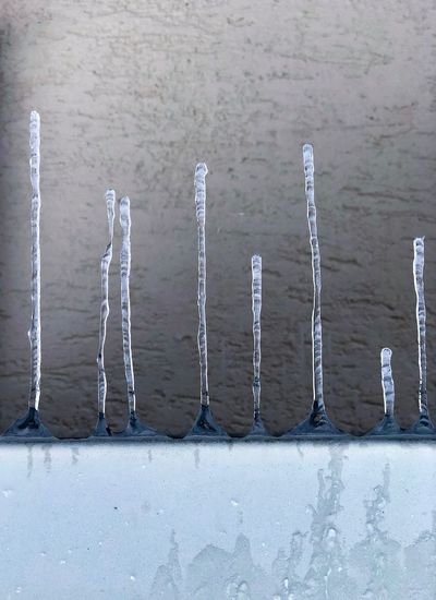 Icicle is going to the air Icicles Dripping Cold Winter ❄⛄ Cold Cold Days Cold Temperature Icing Icicle Ice Metal Day No People High Angle View Text Communication Outdoors City Nature Wall - Building Feature Built Structure 17.62°