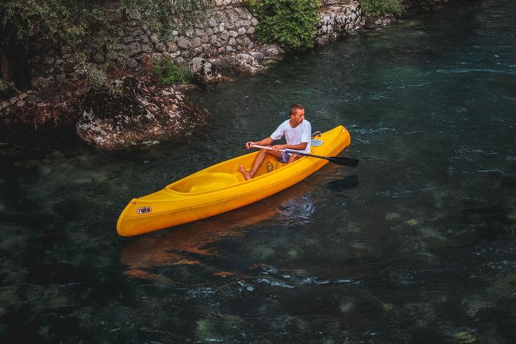 Man rowing boat in water