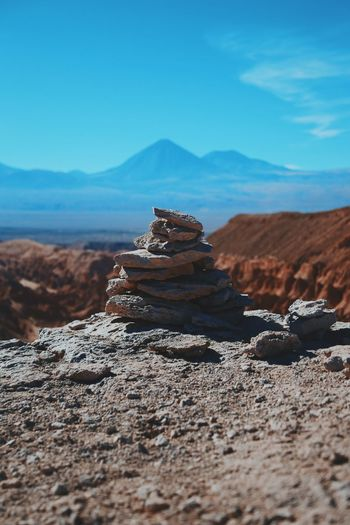 Pile Of Stones With Mountain In Background