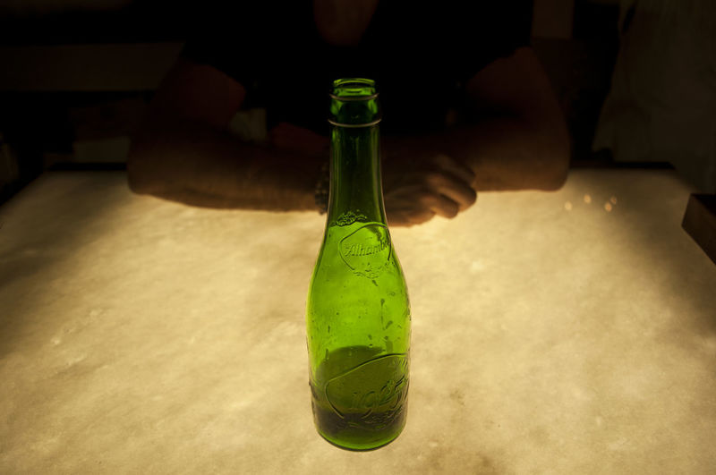 Alhambra Beer Close-up Light And Shadow Light Green Color Bottle Indoors  Drink Refreshment Food And Drink Human Body Part Real People