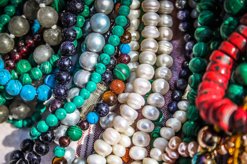closeup of jewelry in India India Abundance Backgrounds Bracelet Choice Close-up Day Fashion For Sale Full Frame Gemstone  Indoors  Jewelry Jewelry Store Large Group Of Objects Luxury Multi Colored Necklace No People Ornament Retail  Variation