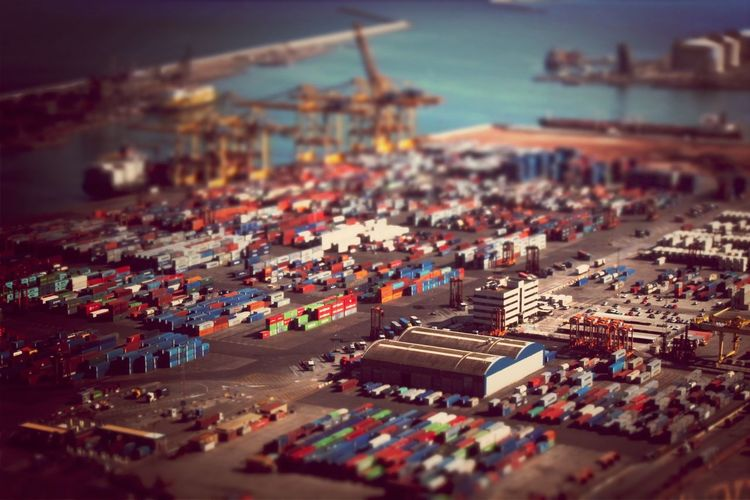 Tilt-shift image of cargo containers at harbor