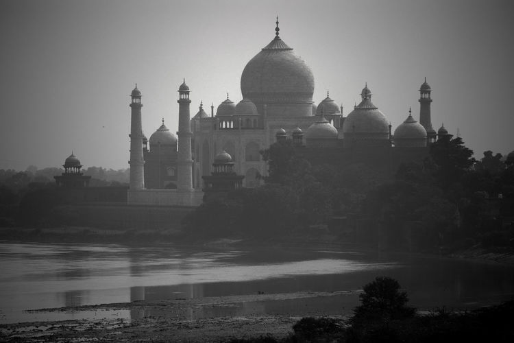 Taj Mahal from river Building Exterior Architecture Religion Water Travel Destinations Dome No People History The Past Travel Belief Taj Mahal Agra