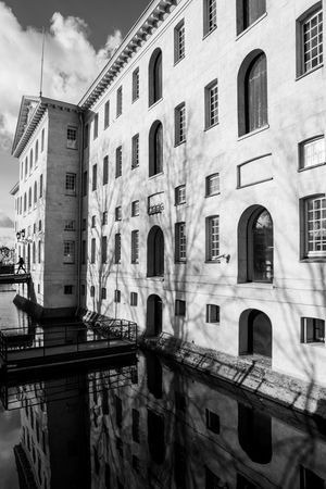 Scheepvaartmuseum in B&W Reflection Scheepvaartmuseum Architecture Blackandwhite Building Exterior Built Structure City Contrast Day Low Angle View Museum No People Outdoors Sky Water Window Windows