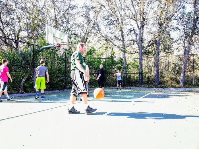 People playing basketball court