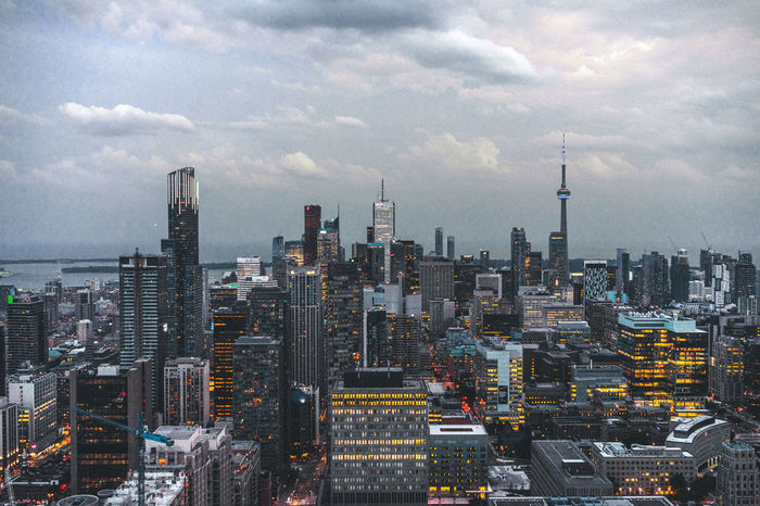 My favourite city shot of all time. Architecture Building Exterior Built Structure City City Cityscape Cloud - Sky CN Tower Day Downtown Modern No People Outdoors Roof Rooftopping Sky Skyline Skyline Skyscraper Tall Tall - High Toronto Tower Travel Destinations Urban Skyline