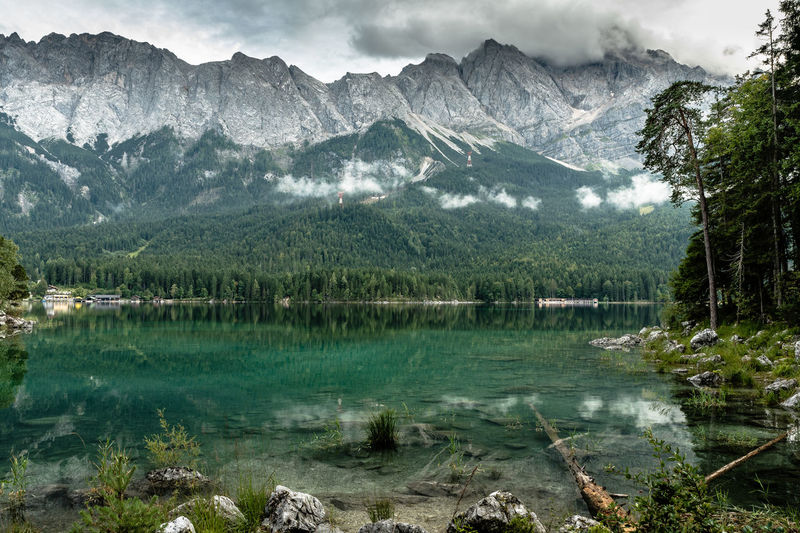 a cloudy day at the Eibsee, unfortunately without a view of the Zugspitze Beauty In Nature Day EyeEmNewHere Forest Green Color Hiking Lake Mountain Mountain Range Mountain View Mountains Nature No People Outdoors Reflection Scenics Sky Tranquil Scene Tranquility Tree Water The Great Outdoors - 2017 EyeEm Awards