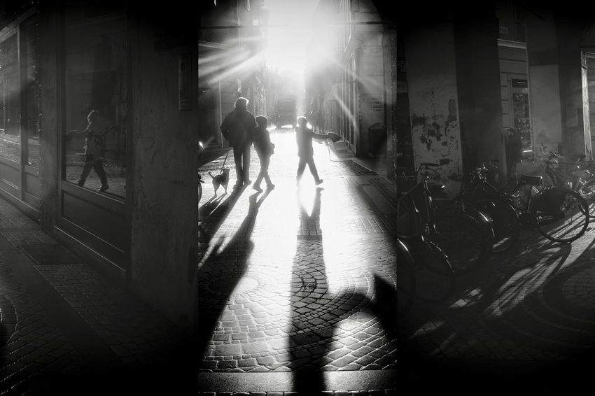 EyeEm Best Shots City Real People Group Of People Sunlight Street Architecture Men Nature Lifestyles Walking Shadow Transportation Adult People Illuminated Wet Building Exterior Outdoors Silhouette Built Structure