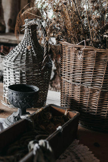 Close-up of wicker basket on wooden table with wooden furniture