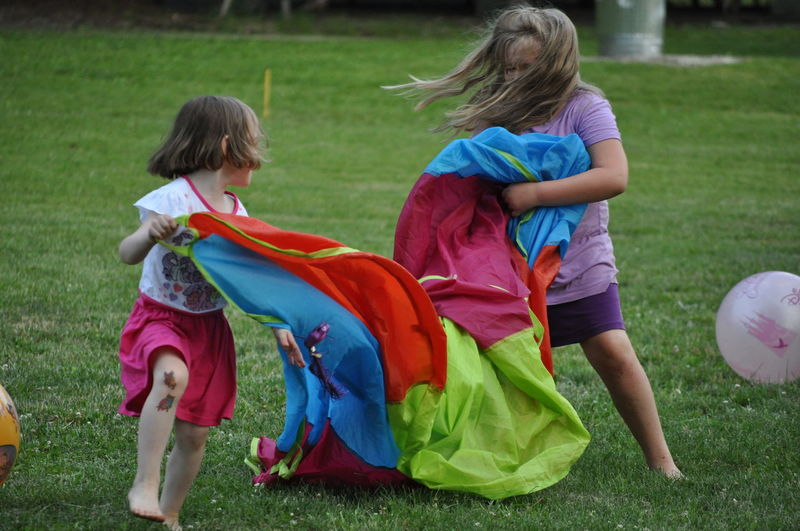 Two Young Girls Playing in a Park Child Childhood Friendship Full Length Girls Leisure Activity Outdoors People Playing Real People Togetherness Two People