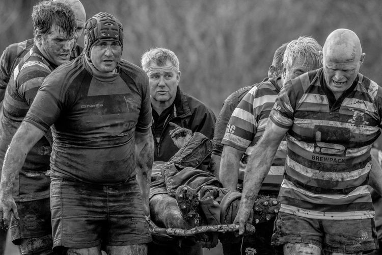 solidarity amongst rugby players TEAMS Tribesman Adult Adults Only Day Group Of People Injury Mammal Mature Adult Mature Men Men Outdoors People Portrait Real People Rugby Senior Adult Senior Men Solidarity Standing Stretcher Teamwork Togetherness