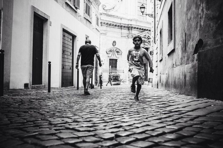 Run boy run // VSCO Vscocam Black & White Streetphoto_bw Blackandwhite Monochrome FUJIFILM X100S Fuji X100s X100S Running