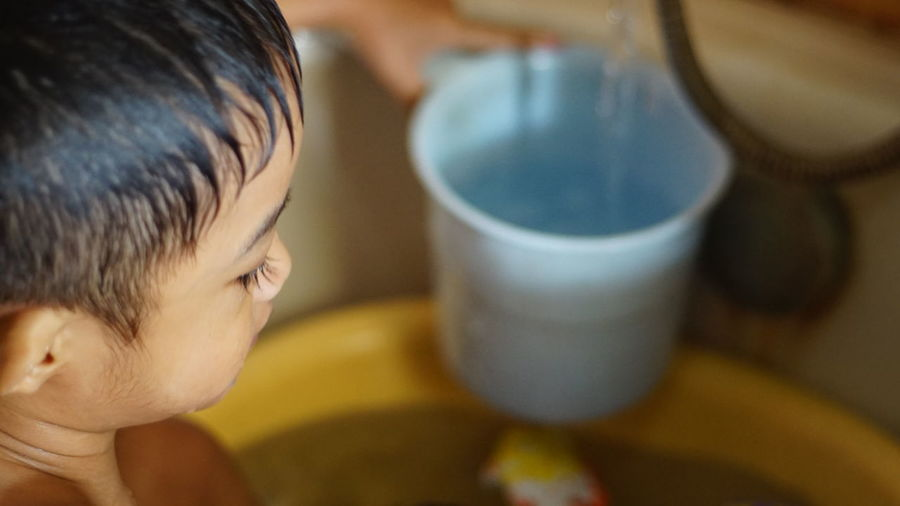 Close-up portrait of boy drinking glass