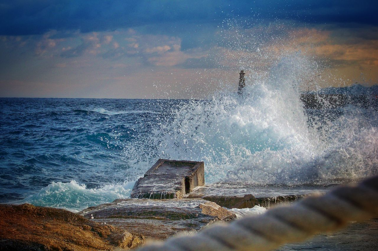 View Of Waves Breaking On Shore