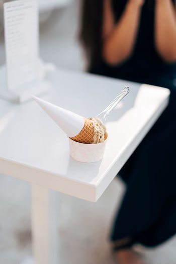 Close-up of ice cream cone on table