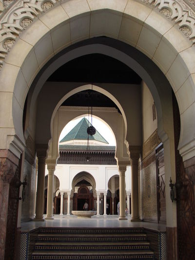 A series od arches in the Grand Mosque in Paris Arch Architecture Architecture Built Structure City Day Grand Mosque Paris Indoors  Landmark Masjid Mosque Muslim Place Of Worship Paris Tourist Destination Travel Destinations Worship