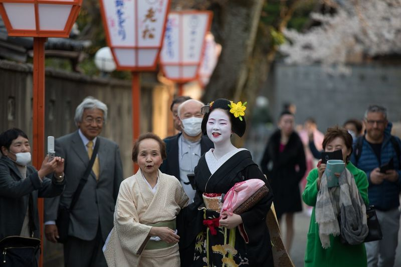 Geisha in Kyoto Kyoto Streetphotography Geiko Geisha Women Men Group Of People Adult Males  Females People Celebration Real People Mature Women Architecture Outdoors