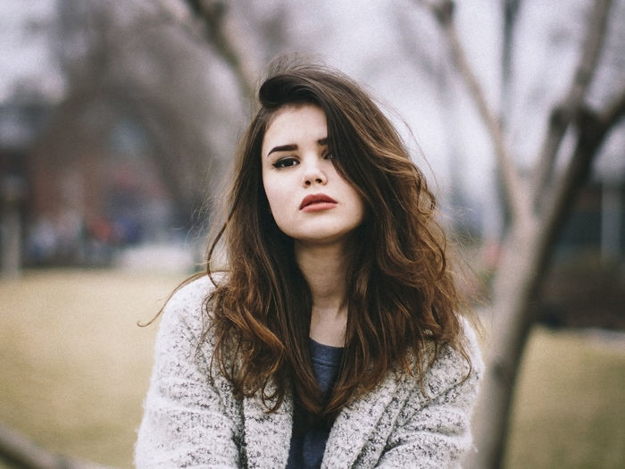 Portrait Of Beautiful Young Woman Standing At Park