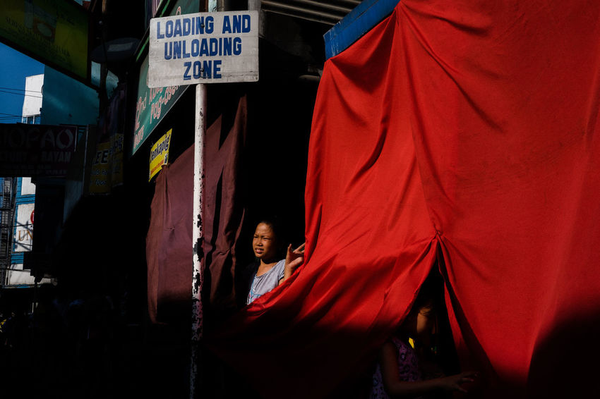 Streetphotography People Red The Human Condition Eyeem Philippines Light And Shadow Everybodystreet Colors Streetphoto_color Street Photography Philippines EyeEm Lucena Street Life Street Chiaroscuro  The Street Photographer - 2017 EyeEm Awards Real People Outdoors Light People And Places Colour Your Horizn