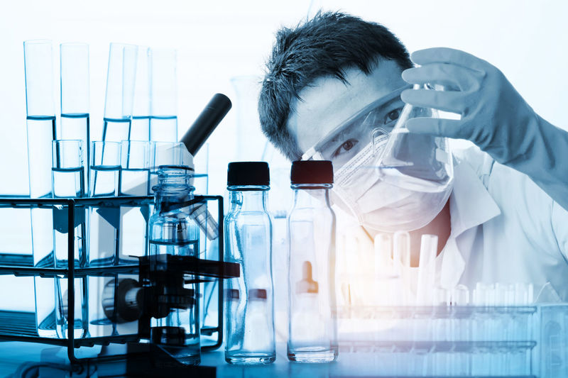 Analyzing Biology Chemistry Clothing Education Healthcare And Medicine Indoors  Lab Coat Laboratory Laboratory Equipment Laboratory Glassware Males  Medical Research Men Microscope Occupation One Person Optical Instrument Real People Research Science Scientific Experiment Scientist Technology