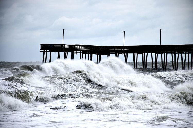 At the beach after a wind storm. Pier Salt Beach Beauty In Nature Breaking Built Structure Flowing Flowing Water Motion Nature No People Ocean Outdoors Power Power In Nature Sand Sea Sky Swim Water Waterfront Wave Waves White White Cap